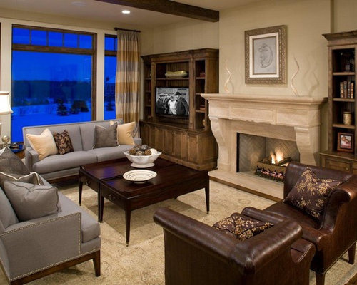 inspiration for a craftsman dark wood floor family room remodel in minneapolis with beige walls