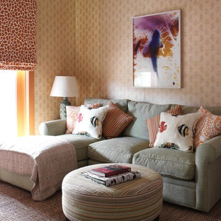 Inspiration for a mid-sized beach style enclosed carpeted family room remodel in New York with beige walls and no fireplace
