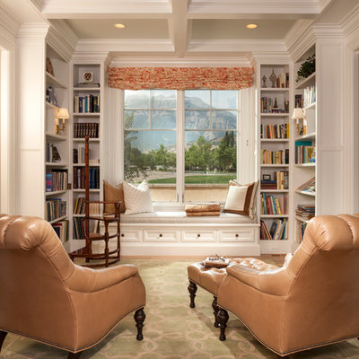 Mid-sized elegant enclosed medium tone wood floor and brown floor family room library photo in Salt Lake City with no fireplace