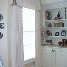 Family Room by Curtain Call Designs