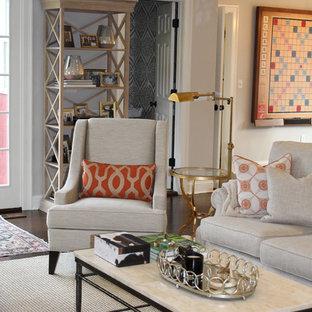 ニューヨークの中サイズのコンテンポラリースタイルのおしゃれなファミリールーム (グレーの壁、濃色無垢フローリング、標準型暖炉、レンガの暖炉まわり、内蔵型テレビ、茶色い床) の写真