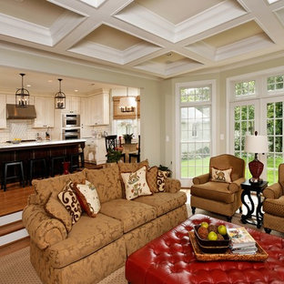 Inspiration for a timeless open concept medium tone wood floor family room remodel in DC Metro with beige walls