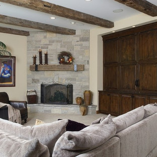 Family Room with Floor to Ceiling Raised Hearth Stone Fireplace
