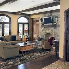 Mediterranean Family Room by Orren Pickell Building Group