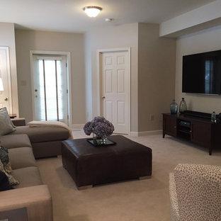 ワシントンD.C.のコンテンポラリースタイルのおしゃれな独立型ファミリールーム (グレーの壁、カーペット敷き、標準型暖炉、レンガの暖炉まわり、壁掛け型テレビ) の写真