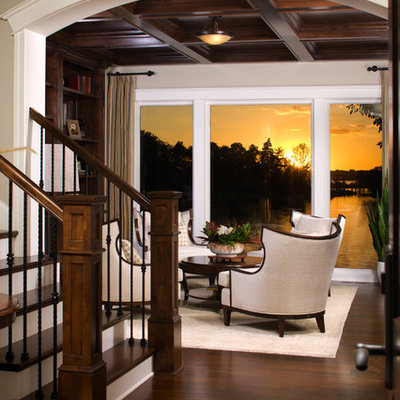 Inspiration for a timeless dark wood floor family room remodel in Minneapolis with beige walls