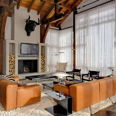Mountain style open concept dark wood floor family room photo in New York with beige walls, a standard fireplace and a wall-mounted tv