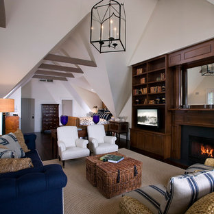 Mid-sized cottage open concept dark wood floor family room photo in Santa Barbara with white walls, a standard fireplace, a media wall and a wood fireplace surround
