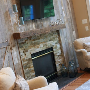 Inspiration for a mid-sized cottage open concept medium tone wood floor family room remodel in New York with beige walls, a standard fireplace, a stone fireplace and a wall-mounted tv