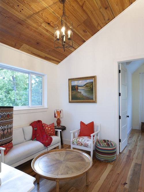 Inspiration For A Farmhouse Medium Tone Wood Floor Family Room Remodel In  Austin With White Walls