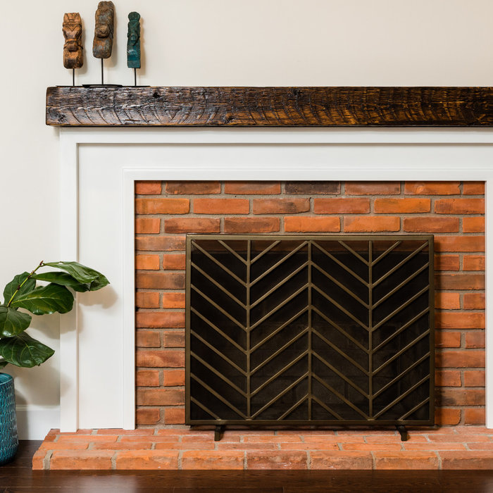 This mantle (and surround) was created by a local woodsmith and artist with wood reclaimed from a Detroit Fire Station in Downtown Detroit Michigan. Each piece is numbered and registered, giving a lit