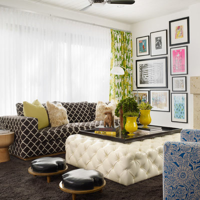 Example of a trendy family room design in Orange County with white walls