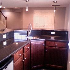 Modern Family Room by Eppinette Construction LLC