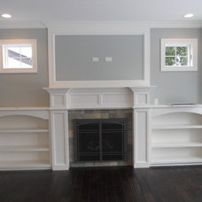 Transitional Family Room by Coora Construction Inc