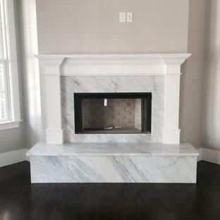 アトランタの中サイズのトラディショナルスタイルのおしゃれなファミリールーム (ベージュの壁、濃色無垢フローリング、コーナー設置型暖炉、石材の暖炉まわり) の写真