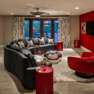 フェニックスの大きいコンテンポラリースタイルのおしゃれなファミリールーム (ホームバー、赤い壁、磁器タイルの床、暖炉なし、壁掛け型テレビ) の写真