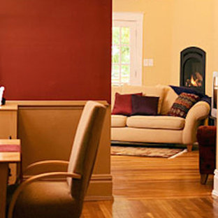 Example of a mid-sized open concept medium tone wood floor family room design in Dallas with red walls, a corner fireplace and a metal fireplace