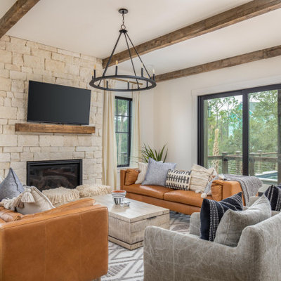 Example of a beach style family room design in Charleston