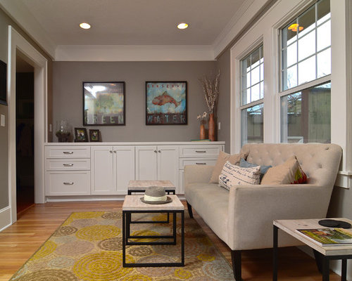 Trendy Enclosed Family Room Photo In Portland With Gray Walls Medium Tone Wood Floors And