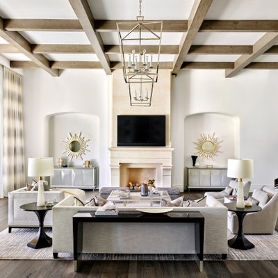 Family room - mediterranean open concept dark wood floor, brown floor and exposed beam family room idea in Phoenix with white walls, a standard fireplace and a wall-mounted tv