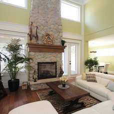 Craftsman Family Room by F. M. Construction Ltd