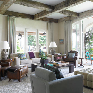 Inspiration for a large mediterranean open plan family and games room in Miami with beige walls, light hardwood flooring, no fireplace, no tv and beige floors.
