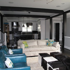 Industrial Family Room by Fowler Custom Homes, Inc.