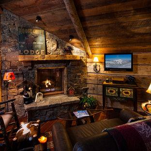 Ejemplo de sala de estar rural con chimenea de esquina