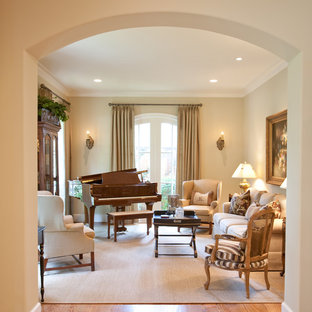 Example of a classic medium tone wood floor family room design in Houston with a music area, beige walls and no tv