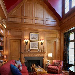 ワシントンD.C.のおしゃれな独立型ファミリールーム (ライブラリー、青い壁、標準型暖炉、木材の暖炉まわり) の写真