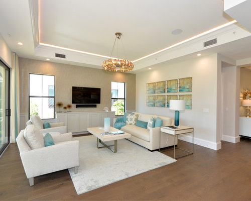 Coastal Medium Tone Wood Floor And Brown Floor Living Room Photo In Miami  With Beige Walls