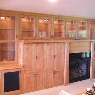 Example of a large arts and crafts family room design in Seattle with a wood fireplace surround and a media wall
