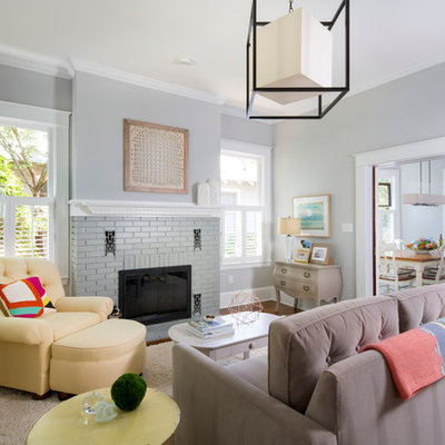Inspiration for a mid-sized transitional open concept dark wood floor family room remodel in Charlotte with gray walls, a standard fireplace and a brick fireplace