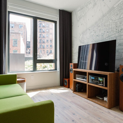 Example of a large trendy enclosed light wood floor and beige floor family room design in New York with a music area, white walls and a tv stand
