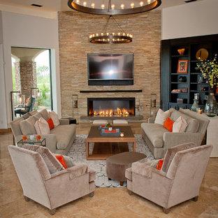 Foto de sala de estar abierta, clásica renovada, de tamaño medio, con paredes blancas, suelo de travertino, chimenea lineal, marco de chimenea de piedra y televisor colgado en la pared