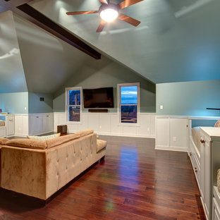 Large trendy open concept medium tone wood floor game room photo in Austin with no fireplace, a wall-mounted tv and blue walls