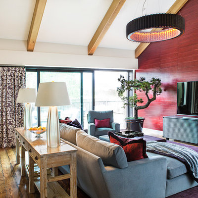 Mid-sized country enclosed medium tone wood floor family room photo in San Francisco with red walls and a tv stand