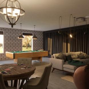 Ispirazione per un grande soggiorno chic chiuso con sala giochi, pareti nere, pavimento in cemento, nessun camino e pavimento grigio