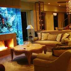 Tropical Family Room by Dezign Inspirations/ Home Design Resource