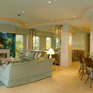 This is an example of a tropical family room in Other.
