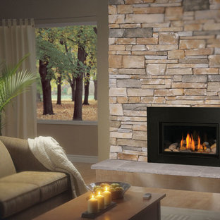 Mid-sized elegant enclosed medium tone wood floor family room photo in Denver with beige walls, a standard fireplace, a stone fireplace and no tv