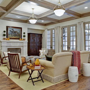 Example of a classic open concept medium tone wood floor family room design in Dallas with beige walls, a standard fireplace and a stone fireplace