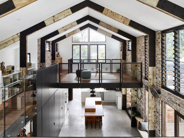 Industrial Family Room by Maytree Studios