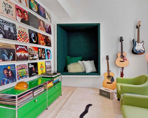 example of a trendy light wood floor and beige floor family room design in san francisco