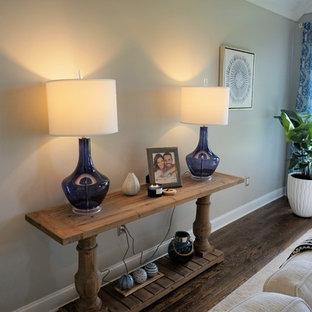 ボルチモアの大きいビーチスタイルのおしゃれな独立型ファミリールーム (グレーの壁、薪ストーブ、石材の暖炉まわり、茶色い床) の写真