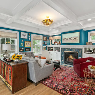 Mid-sized eclectic open concept light wood floor and yellow floor family room photo in Minneapolis with blue walls, a standard fireplace, a tile fireplace and a wall-mounted tv