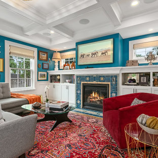 Mid-sized eclectic medium tone wood floor family room photo in Minneapolis with blue walls, a standard fireplace, a tile fireplace and a wall-mounted tv