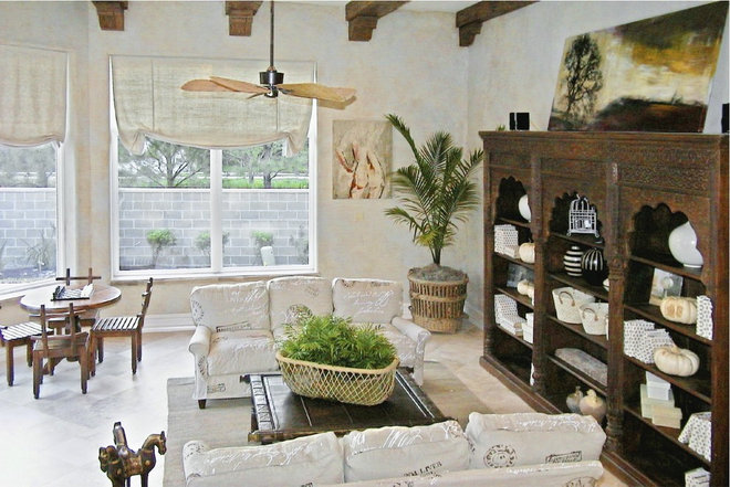 Rustic Family Room by A Waters