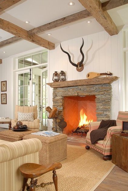 Rustic Family Room by DTM INTERIORS