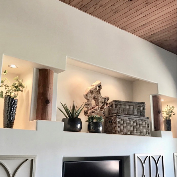 Mid-sized transitional enclosed porcelain tile and beige floor family room photo in Phoenix with beige walls and a tv stand